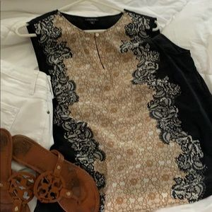 Black top with lace design in front.